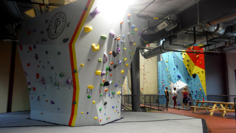 The upstairs bouldering wall on the left, and the Into to Climbing class in the background. Shannon Bryan photo