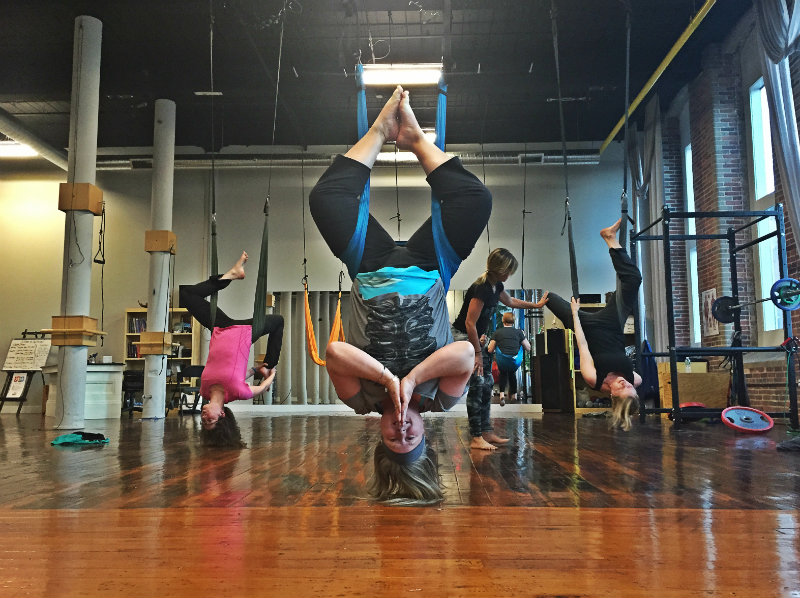 Hanging upside down at Equilibrium in Biddeford during an aerial yoga workshop. This impressive pose is actually pretty easy to do. Shannon Bryan photo