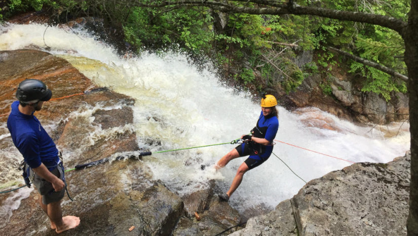 Waterfall rappelling with northeast mountaineering
