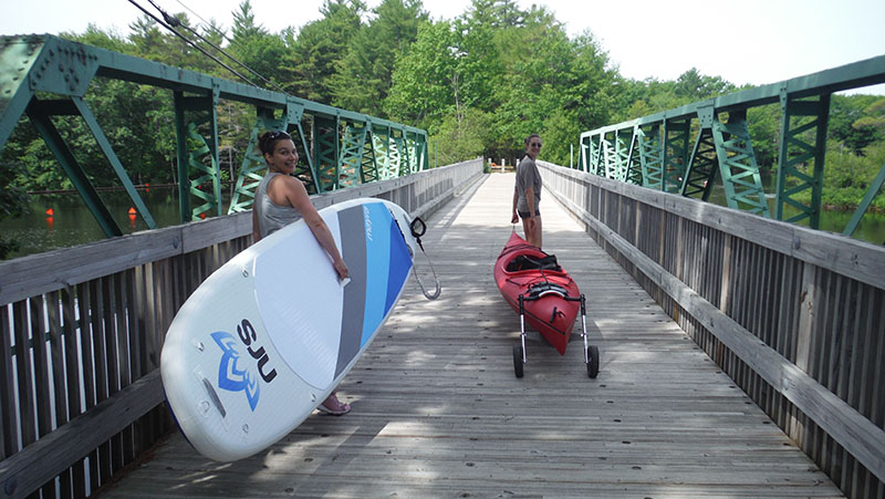 Paddlers hauling their boats and boats to the launch on the other side of the bridge. Shannon Bryan photo