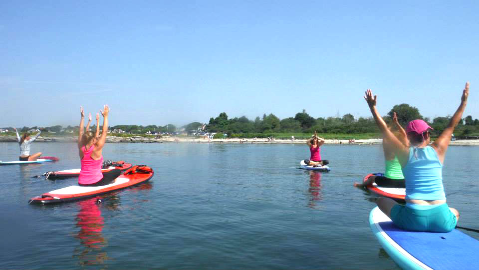 That's Brenda Cyr up front, leading a recent paddleboard yoga class at Kettle Cove in Cape Elizabeth. Shannon Bryan photo