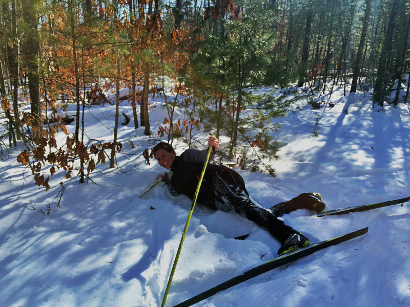 One of a few tumbles into the snow I took during my first couple of times on skate skis. Photo courtesy Elizabeth Ross Holstrom