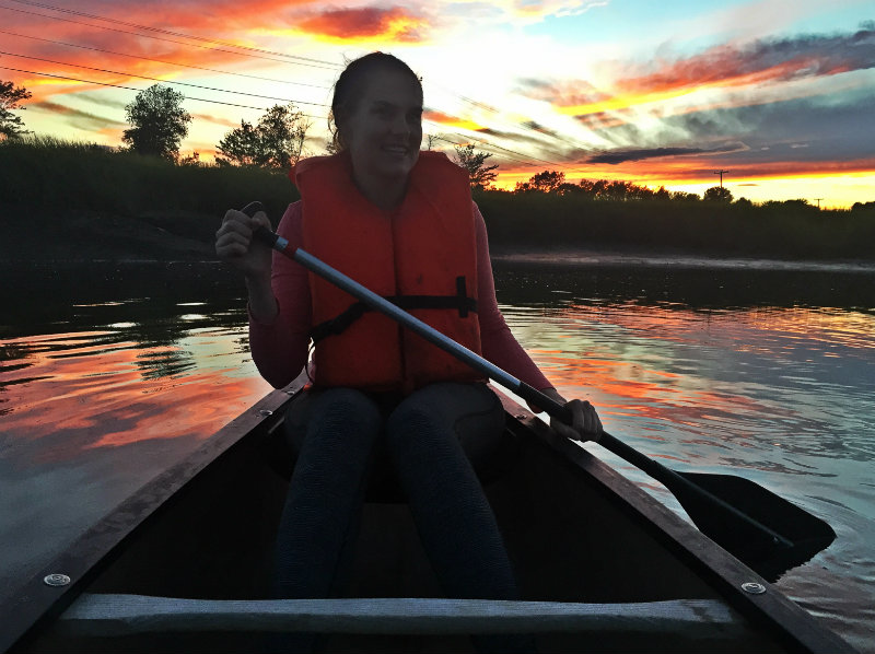Sarah steers the kayak on the Scarborough Marsh with one stunning sunset behind her! Shannon Bryan photo