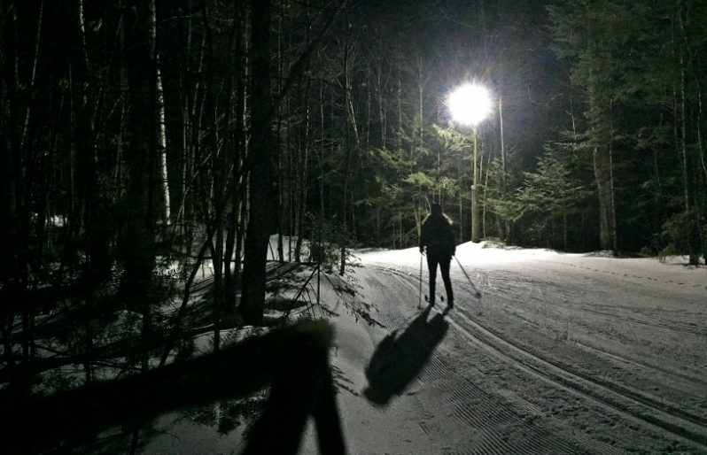 Cross-country skiing under the lights at Titcomb Mountain, Farmington