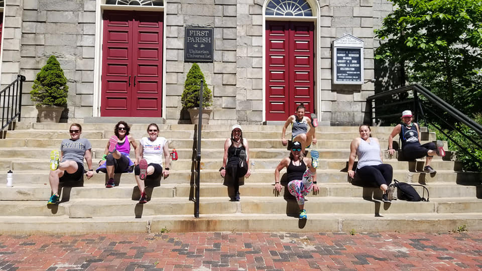 group on church steps doing tricep dips