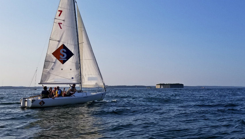 J/22 sailboat on Casco Bay with fort in background